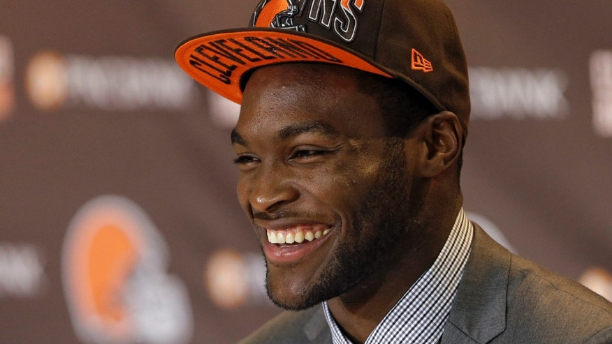 Cleveland Browns first round draft pick Barkevious Mingo laughs during his introductory news conference at the NFL football team's practice facility in Berea, Ohio Friday, April 26, 2013. Mingo, defensive end from LSU, was selected sixth overall in Thursday's NFL draft. (AP Photo/Mark Duncan)