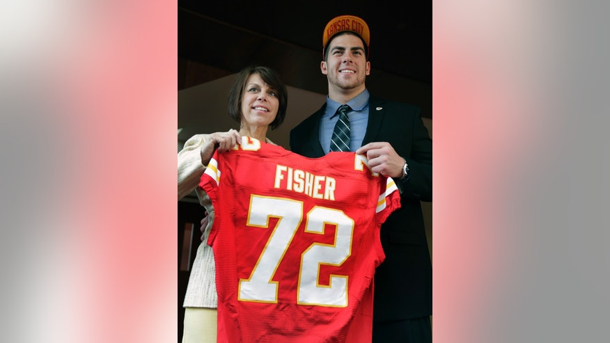 Kansas City Chiefs No. 1 draft pick Eric Fisher, an offensive lineman from Central Michigan, poses with his mother Heidi Langegger, during an NFL football news conference Friday, April 26, 2013, in Kansas City, Mo. Fisher was the No. 1 overall pick in the NFL draft on Thursday. (AP Photo/Charlie Riedel)