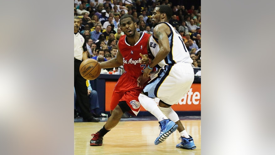 Los Angeles Clippers' Chris Paul, (3) left, moves against Memphis Grizzlies' Mike Conley during the first half of Game 3 in a first-round NBA basketball playoff series, in Memphis, Tenn., Thursday, April 25, 2013. (AP Photo/Danny Johnston)