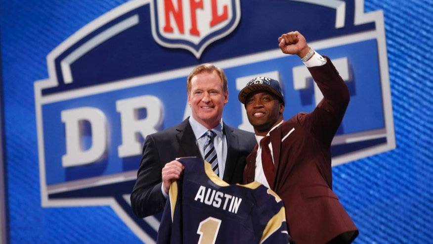 Tavon Austin, from West Virginia, stands with NFL Commissioner Roger Goodell after being selected eighth overall by the Saint Louis Rams in the first round of the NFL football draft, Thursday, April 25, 2013, at Radio City Music Hall in New York. (AP Photo/Jason DeCrow)