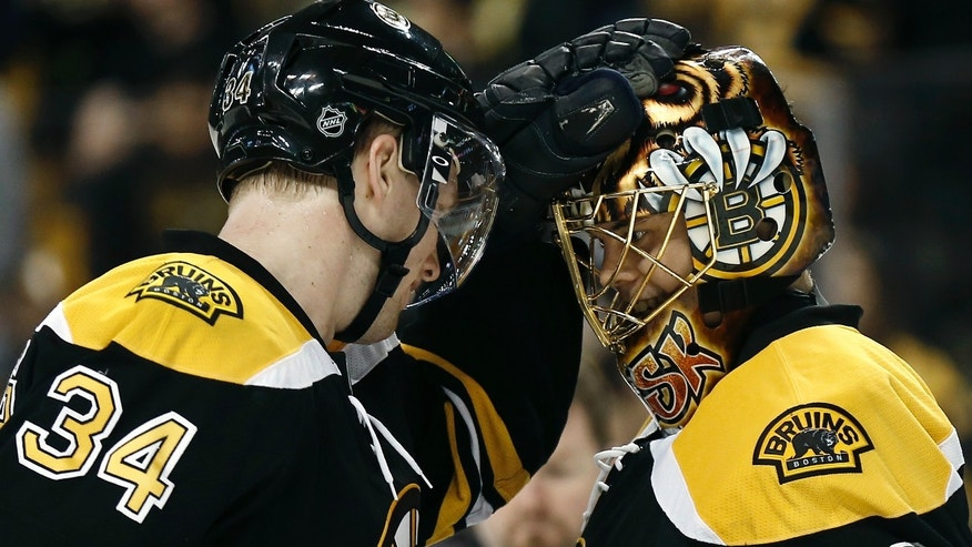 Boston Bruins goalie Tuukka Rask, right, is congratulated by teammate Carl Soderberg after their 2-0 win over the Tampa Bay Lightning in an NHL hockey game in Boston on Thursday, April 25, 2013. (AP Photo/Winslow Townson)