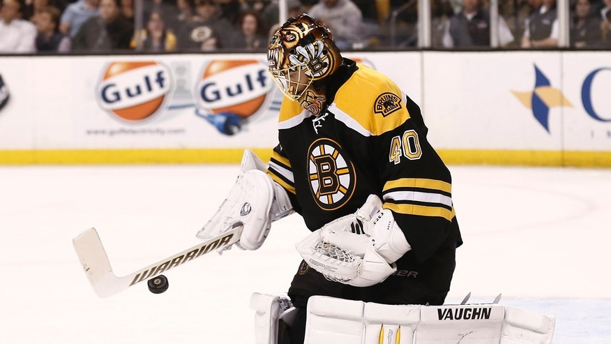 Boston Bruins goalie Tuukka Rask makes a save during the third period of their 2-0 win over the Tampa Bay Lightning in an NHL hockey game in Boston, Thursday, April 25, 2013. (AP Photo/Winslow Townson)