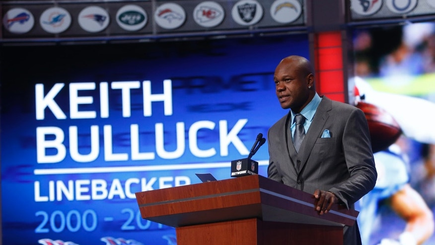 Former NFL football player Keith Bulluck announces the Tennessee Titans draft pick in the second round of the NFL Draft, Friday, April 26, 2013 at Radio City Music Hall in New York., Friday, April 26, 2013 at Radio City Music Hall in New York. The Titans selected Justin Hunter, a wide receiver from Tennessee, with the 34th overall pick in the draft. (AP Photo/Jason DeCrow)