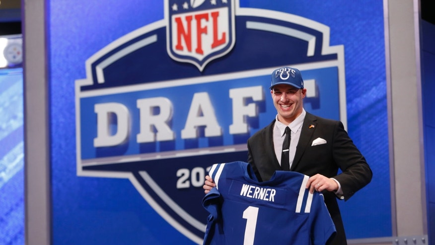Defensive end Bjoern Werner from Florida State holds up the team jersey after being selected 24th overall by the Indianapolis Colts in the first round of the NFL football draft, Thursday, April 25, 2013 at Radio City Music Hall in New York.  (AP Photo/Jason DeCrow)