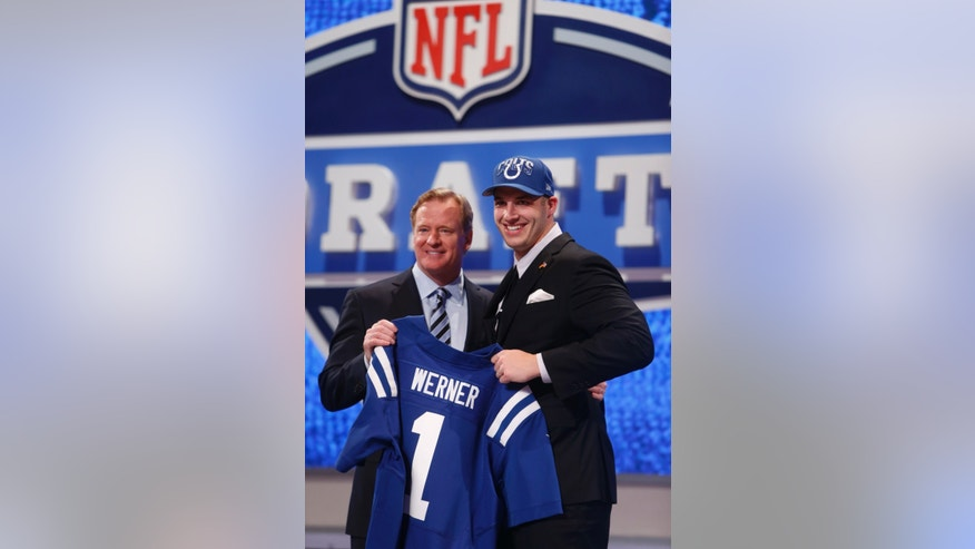 Bjoern Werner, from Florida State, stands with NFL Commissioner Roger Goodell after being selected 24th overall by the Indianapolis Colts in the first round of the NFL football draft, Thursday, April 25, 2013, at Radio City Music Hall in New York.  (AP Photo/Jason DeCrow)
