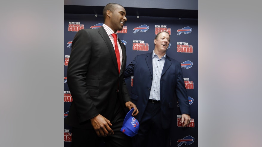The Buffalo Bills No. 1 draft pick quarterback EJ Manuel, from Florida State, talks with former Bills quarterback Jim Kelly after an NFL football news conference at Ralph Wilson Stadium in Orchard Park, N.Y., Friday, April 26, 2013. Manuel was selected 16th overall in the first round of the NFL draft on Thursday. (AP Photo/David Duprey)