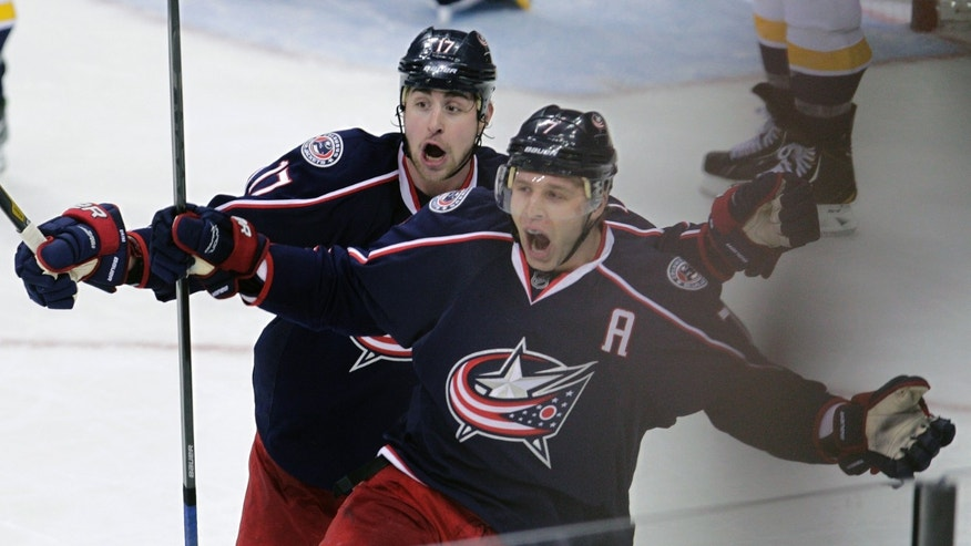 Columbus Blue Jackets' Brandon Dubinsky, left, and Jack Johnson celebrate Johnson's game-winning goal against the Nashville Predators during the third period of an NHL hockey game on Saturday, April 27, 2013, in Columbus, Ohio. The Blue Jackets defeated the Predators 3-1. (AP Photo/Jay LaPrete)
