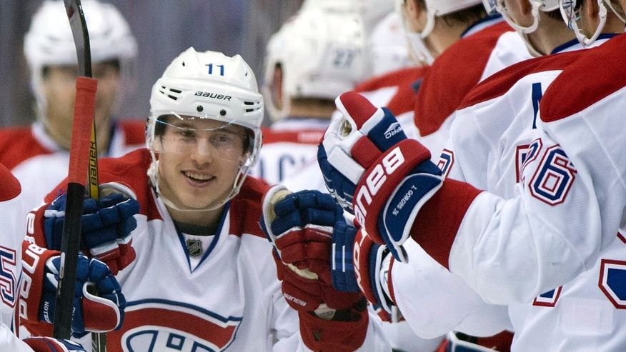 Montreal Canadiens right winger Brendan Gallagher celebrates his goal against the Toronto Maple Leafs during the second period of an NHL hockey game in Toronto on Saturday, April 27, 2013. (AP Photo/The Canadian Press, Frank Gunn)