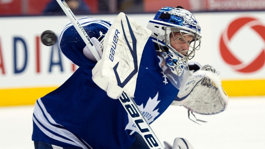 Toronto Maple Leafs goaltender James Reimer makes a save on the Montreal Canadiens during the first period of an NHL hockey game in Toronto on Saturday, April 27, 2013. (AP Photo/The Canadian Press, Frank Gunn)