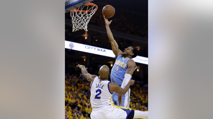 Denver Nuggets' Andre Iguodala (9) lays up a shot against Golden State Warriors' Jarrett Jack (2) during the first half of Game 3 in a first-round NBA basketball playoff series on Friday, April 26, 2013, in Oakland, Calif. (AP Photo/Ben Margot)
