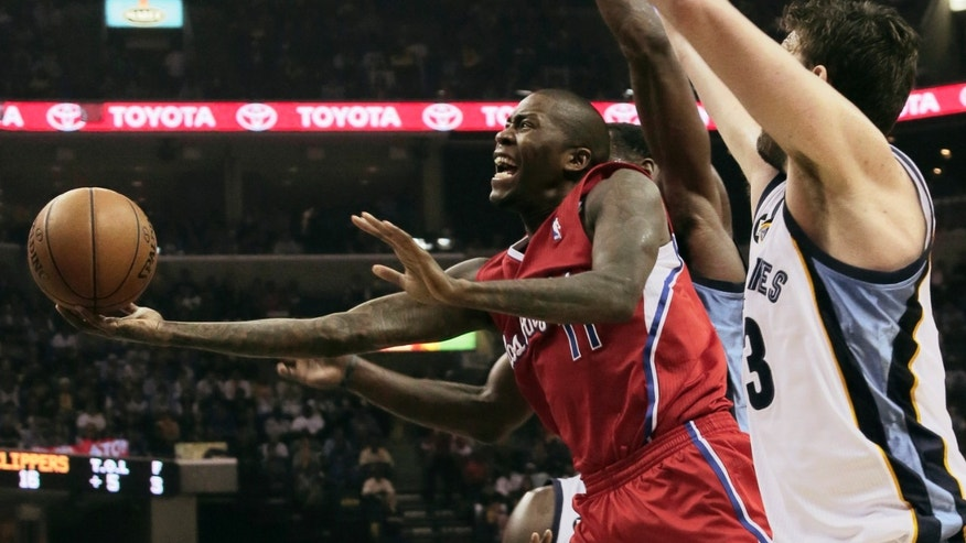 Memphis Grizzlies' Marc Gasol, of Spain, right, defends against Los Angeles Clippers' Jamal Crawford (11) during the first half of Game 4 in a first-round NBA basketball playoff series in Memphis, Tenn., Saturday, April 27, 2013. (AP Photo/Danny Johnston)
