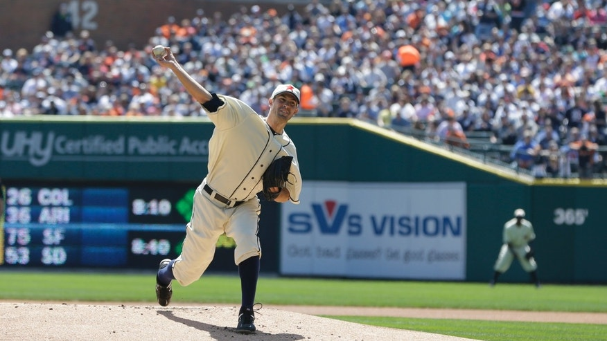 Detroit Tigers starting pitcher Rick Porcello throws during the first inning of an interleague baseball game in Detroit, Saturday, April 27, 2013. (AP Photo/Carlos Osorio)