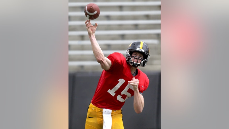 Iowa quarterback Jake Rudock throws a pass during their spring NCAA college football game at Kinnick Stadium in Iowa City on Saturday, April 27, 2013. (AP Photo/Iowa City Press-Citizen, Benjamin Roberts )  NO SALES