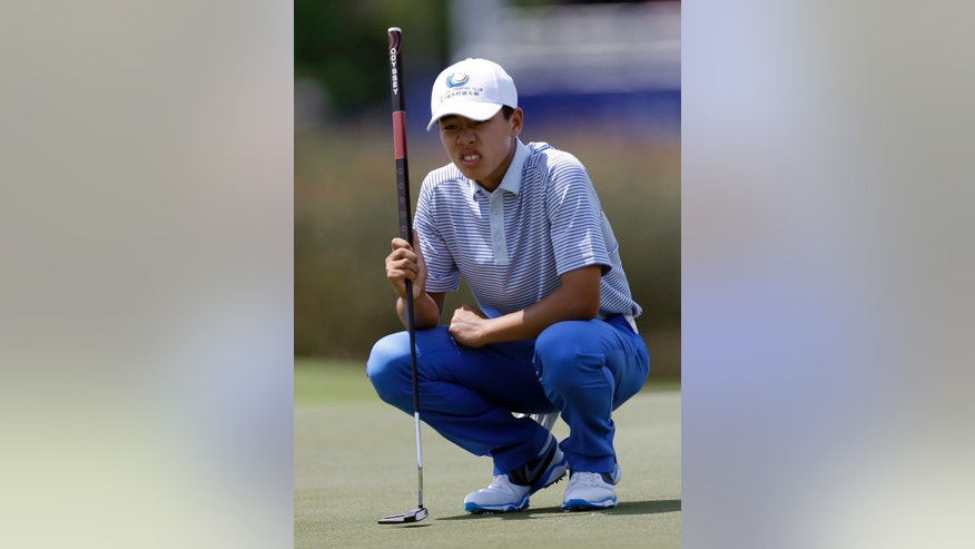 Guan Tianlang, 14, of China, lines up a putt on the 18th hole during the third round of the PGA Zurich Classic golf tournament at TPC Louisiana in Avondale, La., Saturday, April 27, 2013. (AP Photo/Gerald Herbert)