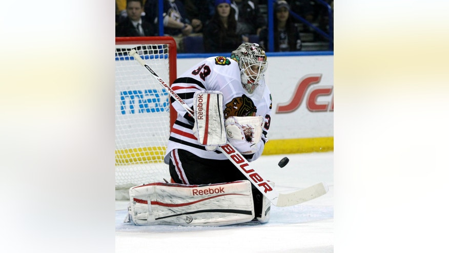 Chicago Blackhawks goalie Carter Hutton (33) makes a save in the second period of an NHL hockey game against the St. Louis Blues, Saturday, April 27, 2013 in St. Louis. (AP Photo/Tom Gannam)