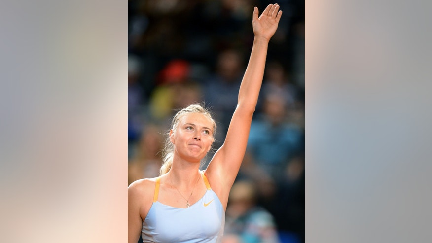 Russia's Maria  Sharapova waves after winning the semi-final match against Germany's Angelique Kerber at the WTA Porsche Tennis Grand Prix in Stuttgart, Germany, 27 April 2013. Sharapova won the match with 6-3, 2-6 and 7-5. (AP Photo/dpa, Bernd Weissbrod)