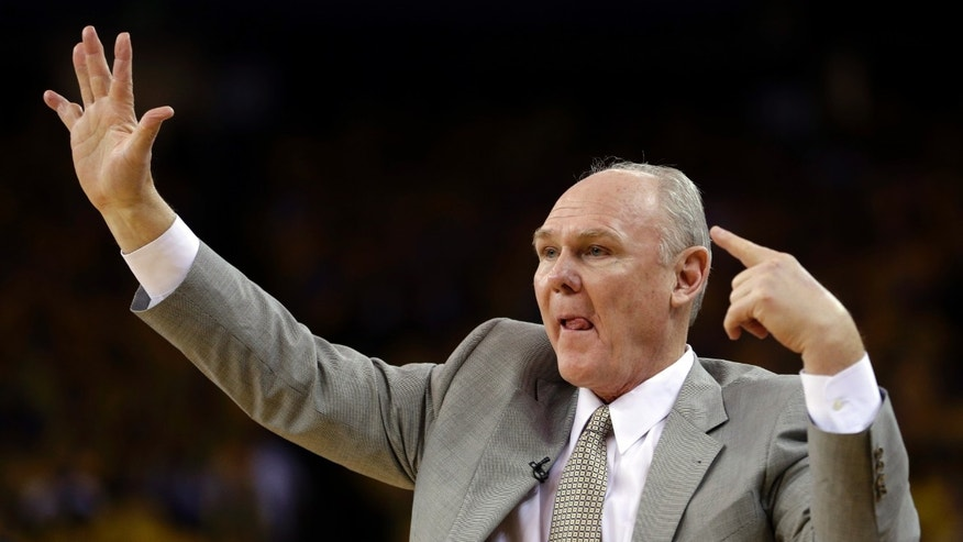 Denver Nuggets coach George Karl gestures from the sidelines during the second half of Game 3 in a first-round NBA basketball playoff series against the Golden State Warriors on Friday, April 26, 2013, in Oakland, Calif. (AP Photo/Ben Margot)