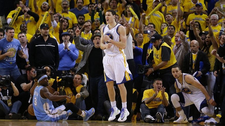 Golden State Warriors' Klay Thompson reacts, center, as Denver Nuggets' Ty Lawson watches, left, during the second half of Game 3 in a first-round NBA basketball playoff series on Friday, April 26, 2013, in Oakland, Calif. (AP Photo/Ben Margot)