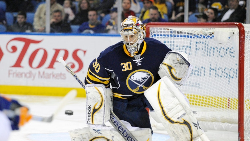 Buffalo Sabres goaltender Ryan Miller watches the shot off a New York Islanders'  stick during the second period of an NHL hockey game in Buffalo, N.Y., Friday, April 26, 2013. (AP Photo/Gary Wiepert)