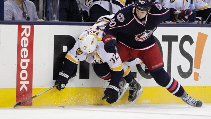 Columbus Blue Jackets' Jared Boll, right, checks Nashville Predators' Joonas Rask, of Finland, during the first period of an NHL hockey game on Saturday, April 27, 2013, in Columbus, Ohio. (AP Photo/Jay LaPrete)
