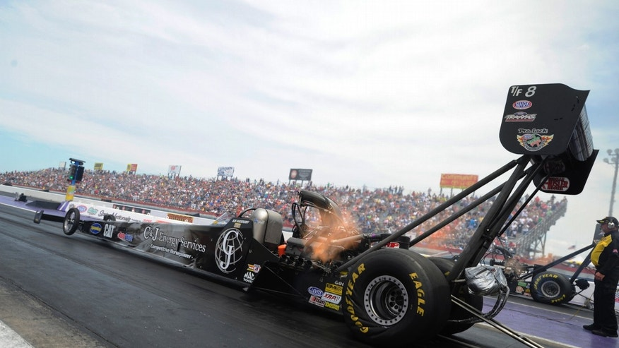 In this photo provided by NHRA, Bob Vandergriff launches from the starting line at Royal Purple Raceway in his C&J Energy Services dragster and powers to his third career Top Fuel victory in the final round of the O'Reilly Auto Parts NHRA SpringNationals auto race, Sunday, April 28, 2013, at Royal Purple Raceway in Baytown, Texas. (AP Photo/NHRA, Jerry Foss)