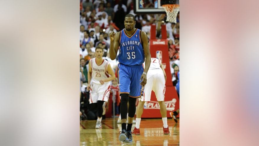 Oklahoma City Thunder's Kevin Durant (35) reacts after making a three-point basket against the Houston Rockets during the closing seconds of the fourth quarter of Game 3 in a first-round NBA basketball playoff series Saturday, April 27, 2013, in Houston. The Thunder beat the Rockets 104-101. (AP Photo/David J. Phillip)