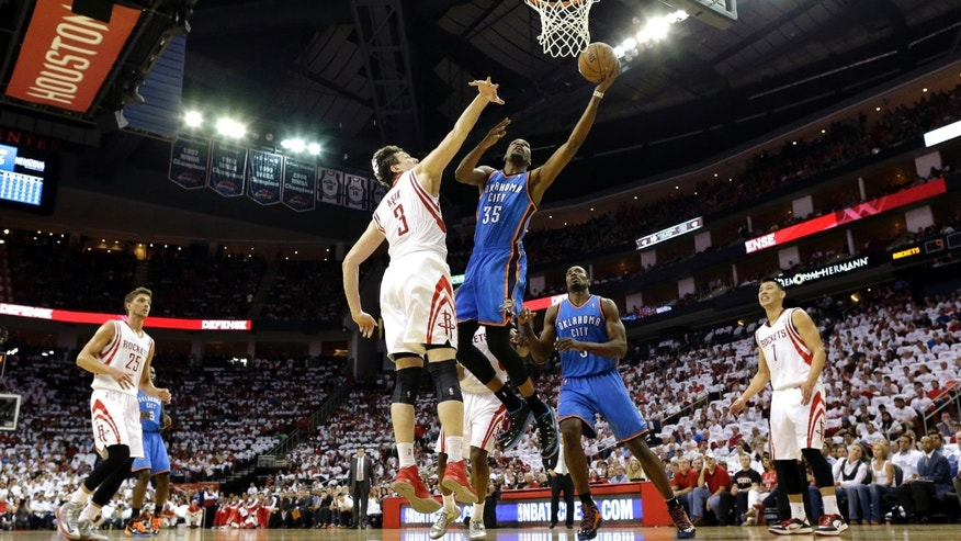 Oklahoma City Thunder's Kevin Durant (35) goes up for a shot as Houston Rockets' Omer Asik (3) defends during the first quarter of Game 3 in a first-round NBA basketball playoff series Saturday, April 27, 2013, in Houston. (AP Photo/David J. Phillip)