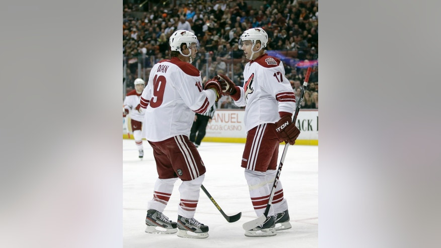 Phoenix Coyotes right wing Radim Vrbata, right, celebrates his goal with teammate Shane Doan during the first period of an NHL hockey game against the Anaheim Ducks in Anaheim, Calif., Saturday, April 27, 2013. (AP Photo/Chris Carlson)
