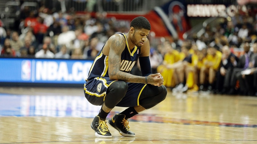 Indiana Pacers small forward Paul George (24) reacts against the Atlanta Hawks during the second half in Game 3 of their first-round NBA basketball playoff series, Saturday, April 27, 2013 in Atlanta. (AP Photo/John Bazemore)
