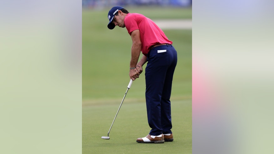 Billy Horschel putts on the first green during the final round of the PGA Zurich Classic golf tournament at TPC Louisiana in Avondale, La., Sunday, April 28, 2013. (AP Photo/Gerald Herbert)