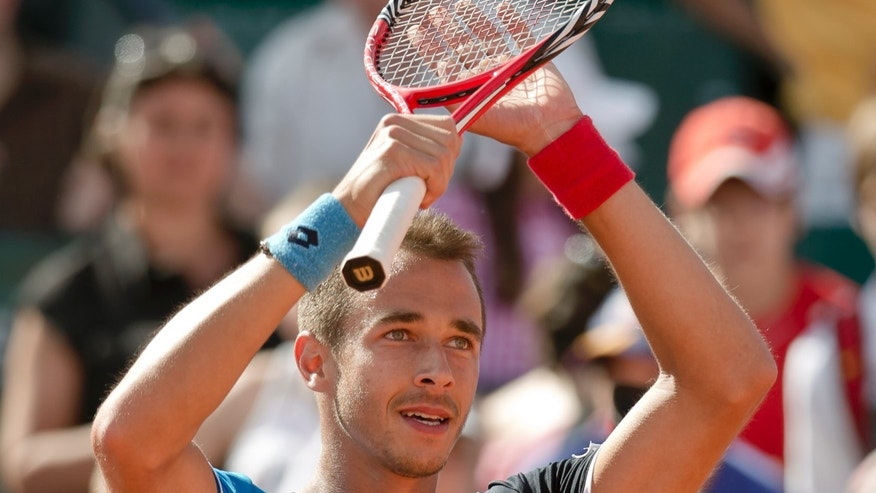 Lukas Rosol of the Czech Republic reacts after winning the BRD Nastase Tiriac 2013 Trophy ATP tennis tournament in Bucharest, Romania, Sunday, April 28, 2013. Rosol defeated Guillermo Garcia-Lopez of Spain in the final match. (AP Photo/Vadim Ghirda)
