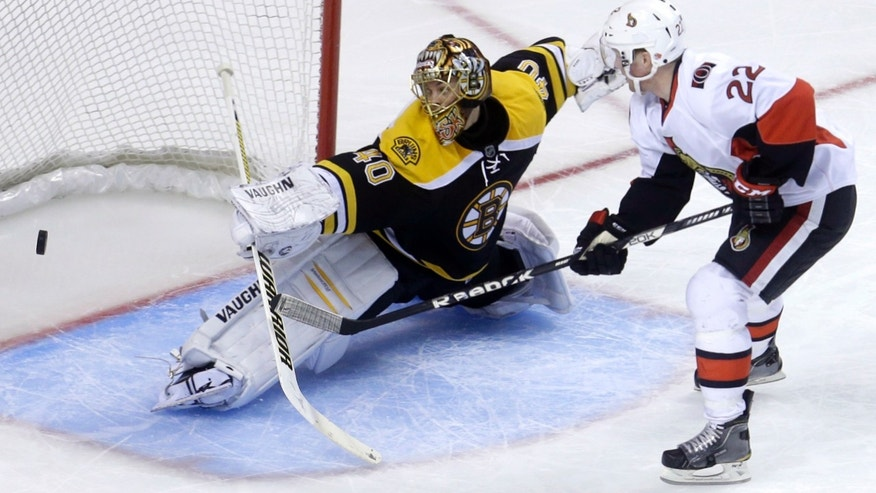 Boston Bruins goalie Tuukka Rask (40), of Finland, left, deflects a shot on goal by Ottawa Senators right wing Erik Condra (22), right, in the third period of an NHL hockey game at the TD Garden, in Boston, Sunday, April 28, 2013. The Senators beat the Bruins 4-2. (AP Photo/Steven Senne)
