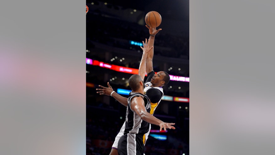 Los Angeles Lakers center Dwight Howard, right, shoots as San Antonio Spurs forward Tim Duncan defends during the first half in Game 4 of a first-round NBA basketball playoff series, Sunday, April 28, 2013, in Los Angeles. (AP Photo/Mark J. Terrill)
