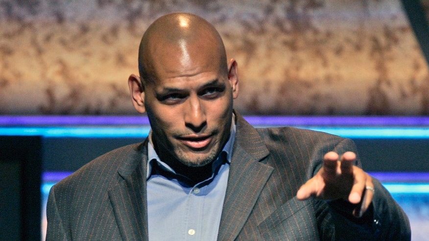 FILE- Former NBA player John Amaechi speaks onstage at the 18th Annual GLAAD Media Awards at the Kodak Theatre in Los Angeles, USA, in this file photo dated Saturday, April 14, 2007.  Amaechi became the first openly gay former NBA player with a landmark public statement in 2007, three years after retiring, but in a telephone interview with The Associated Press, Amaechi disclosed that he is in contact with gay English Premier League players to advise them about gay issues.  (AP Photo/Chris Carlson, FILE)