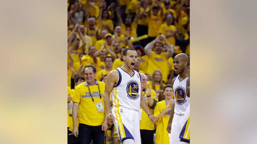 Golden State Warriors' Stephen Curry (30) reacts after scoring against the Denver Nuggets during the second half of Game 4 in a first-round NBA basketball playoff series on Sunday, April 28, 2013, in Oakland, Calif. (AP Photo/Ben Margot)