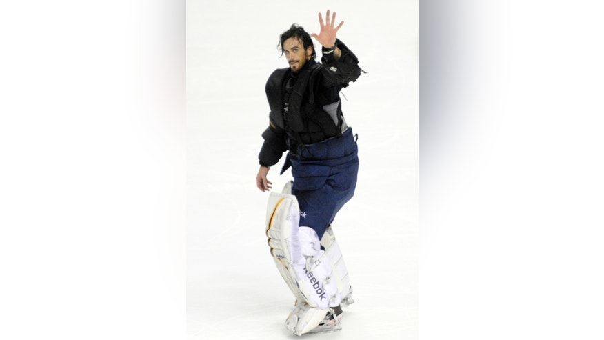 Buffalo Sabres goaltender Ryan Miller waves to the crowd after an NHL hockey game against the New York Islanders in Buffalo, N.Y., Friday, April 26, 2013. Miller, who started his 500th NHL game, helped the Sabres beat the Islanders, 2-1. (AP Photo/Gary Wiepert)