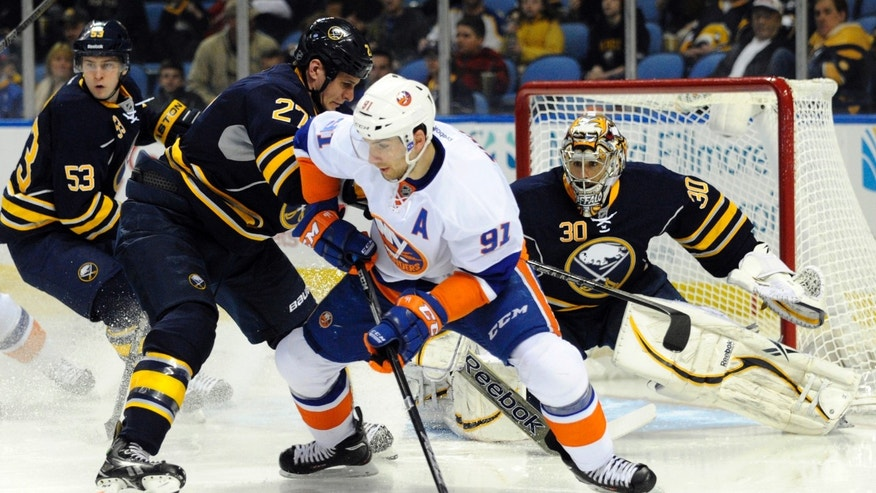 Buffalo Sabres defenseman Adam Pardy (27) tangles with New York Islanders center John Tavares (91) as Sabres goaltender Ryan Miller (30) defends during the second period of an NHL hockey game in Buffalo, N.Y., Friday, April 26, 2013. (AP Photo/Gary Wiepert)
