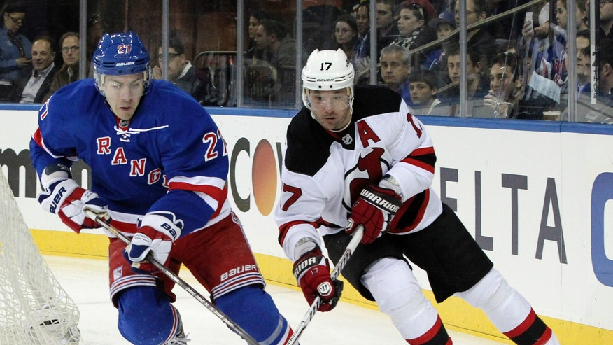 New York Rangers' Ryan McDonagh (27) and New Jersey Devils' Ilya Kovalchuk, of Russia, battle for the puck during the first period of an NHL hockey game Saturday, April 27, 2013 at Madison Square Garden in New York.  (AP Photo/Mary Altaffer)