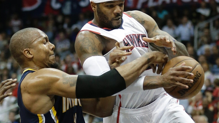 Indiana Pacers power forward David West (21) vies for a loose ball against Atlanta Hawks small forward Josh Smith (5) during the second half in Game 4 of their first-round NBA basketball playoff series,basketball game Monday, April 29, 2013 in Atlanta.  (AP Photo/John Bazemore)