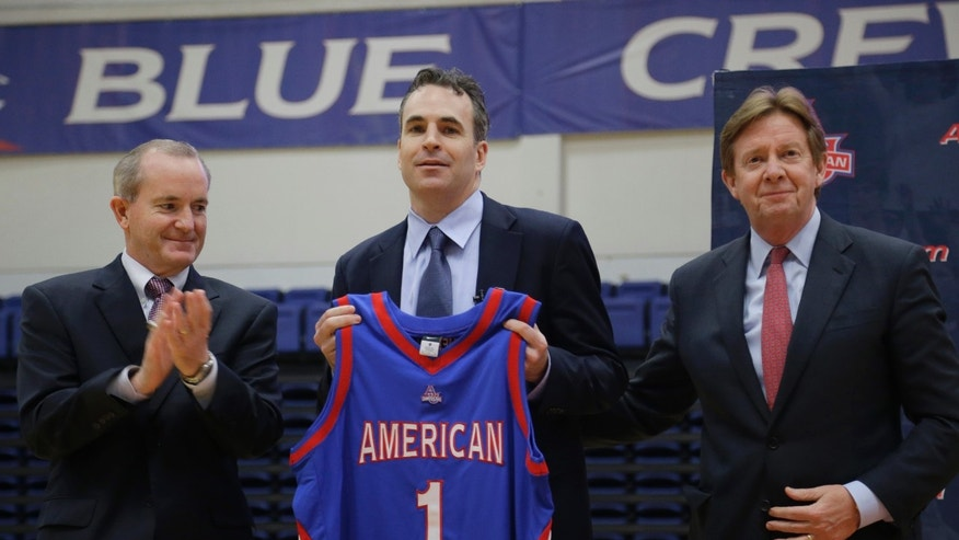 American University athletic director Billy Walker, left, university president Neil Kerwin, right, stand with Mike Brennan, the university's new men's basketball coach, during a media availability Tuesday, April 30, 2013, in Washington. (AP Photo/Alex Brandon)