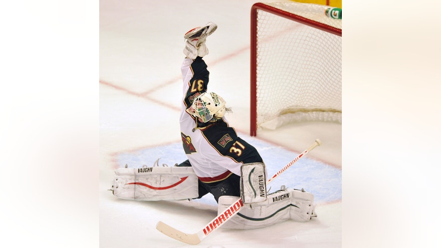 Minnesota Wild's Josh Harding makes a save on a shot by Chicago Blackhawks' Patrick Sharp during the second period of Game 1 of an NHL hockey Stanley Cup playoff series Tuesday, April 30, 2013, in Chicago. (AP Photo/Jim Prisching)
