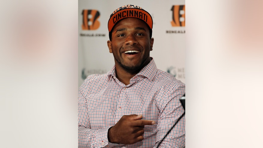 Cincinnati Bengals second round draft pick Giovani Bernard, a halfback out of North Carolina, gestures during a news conference, Saturday, April 27, 2013, in Cincinnati. (AP Photo/Al Behrman)