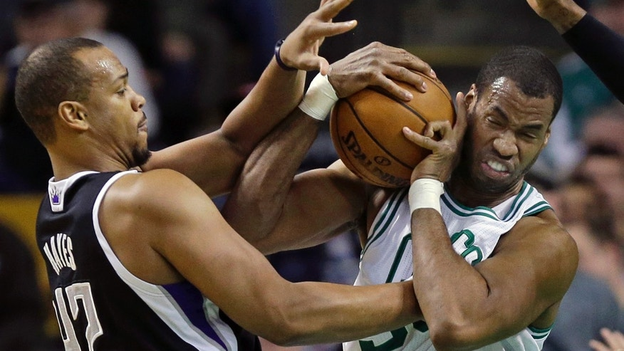 "FILE - In this Jan. 30, 2013, file photo, Boston Celtics center Jason Collins, right, struggles for control of the ball with Sacramento Kings forward Chuck Hayes (42) during the second half of an NBA basketball game in Boston. ESPN says that it regrets the ""distraction"" caused by one of its reporters who described Jason Collins as a sinner after the NBA center publicly revealed that he was gay. Chris Broussard, who covers the NBA for ESPN, had said on the air that Collins and others in the NBA who engage in premarital sex or adultery were ""walking in open rebellion to God, and to Jesus Christ.""  (AP/Elise Amendola, File)"