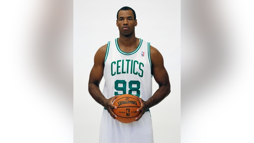 FILE - In a Friday, Sept. 28, 2012 file photo, Boston Celtics' Jason Collins poses during Celtics NBA basketball media day at the team's training facility in Waltham, Mass. NBA veteran center Collins has become the first male professional athlete in the major four American sports leagues to come out as gay. Collins wrote a first-person account posted Monday, April 29, 2013 on Sports Illustrated's website. He finished this past season with the Washington Wizards and is now a free agent. (AP Photo/Michael Dwyer, File)