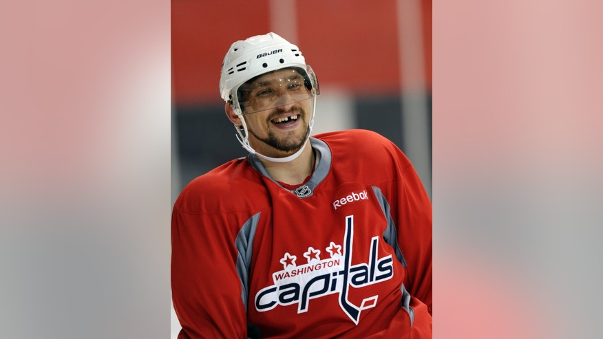 Washington Capitals' Alex Ovechkin, of Russia, smiles during NHL hockey practice at the Kettler Capitals Iceplex in Arlington, Va., Tuesday, April 30, 2013. By scoring 22 times in the last 21 games, Ovechkin claimed his third goal-scoring title and led the Washington Capitals to the Southeast Division title. Yes, Alexander the Great is back at his best and will face the New York Rangers in the playoffs. (AP Photo/Susan Walsh)