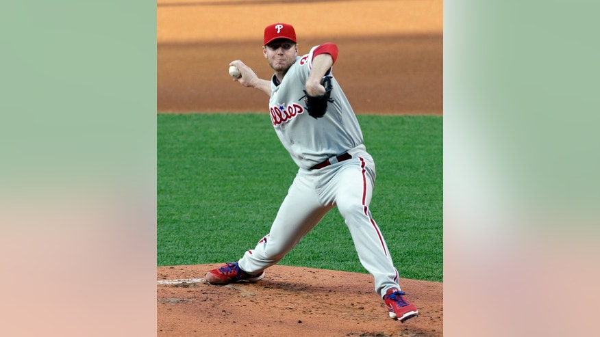 Philadelphia Phillies starting pitcher Roy Halladay delivers a pitch during the first inning of a baseball game against the Cleveland Indians, Tuesday, April 30, 2013, in Cleveland. (AP Photo/Tony Dejak)