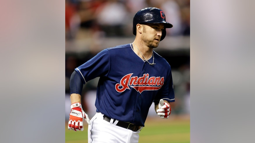 Cleveland Indians' Ryan Raburn runs the bases after hitting a two-run home run off Philadelphia Phillies relief pitcher Chad Durbin in the fifth inning of a baseball game, Tuesday, April 30, 2013, in Cleveland. Jason Giambi scored. (AP Photo/Tony Dejak)
