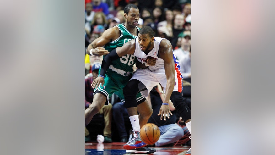 FILE - In this Jan. 20, 2013 file photo, then-Boston Celtics center Jason Collins (98) guards Detroit Pistons center Greg Monroe, right, in the second half of an NBA basketball game in Auburn Hills, Mich. Jason Collins has become the first male professional athlete in the major four American sports leagues to come out as gay. Collins wrote a first-person account posted Monday on Sports Illustrated's website. The 34-year-old Collins has played for six NBA teams in 12 seasons. He finished this past season with the Washington Wizards and is now a free agent. He says he wants to continue playing. (AP Photo/Duane Burleson, File)