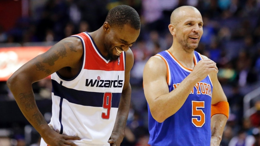 FILE - In this March 1, 2013, file photo, Washington Wizards forward Martell Webster (9) and New York Knicks guard Jason Kidd (5) laugh during the first half of an NBA basketball game in Washington. Kidd is the recipient of the Joe Dumars Trophy presented to the 2012-13 NBA Sportsmanship Award winner, the NBA announced Tuesday, April 30, 2013. (AP Photo/Alex Brandon, File)