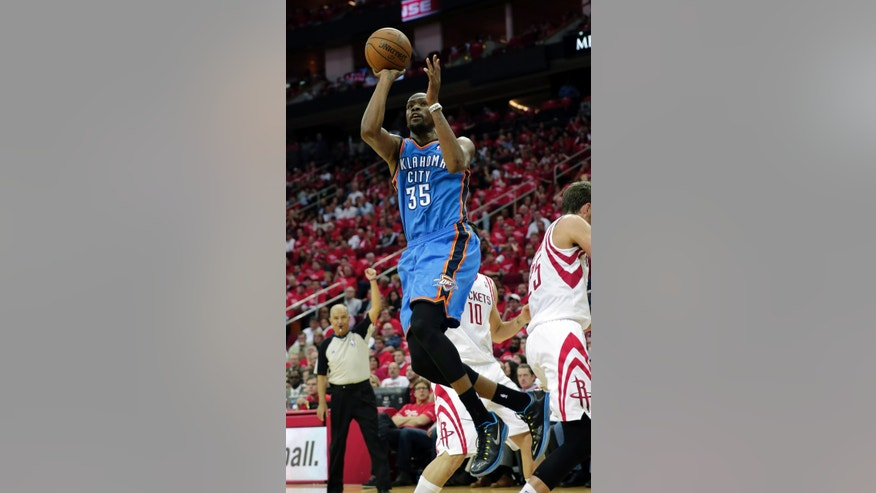 Oklahoma City Thunder's Kevin Durant (35) shoots against the Houston Rockets during the second quarter of Game 4 in their first-round NBA basketball playoff series Monday, April 29, 2013, in Houston. (AP Photo/David J. Phillip)